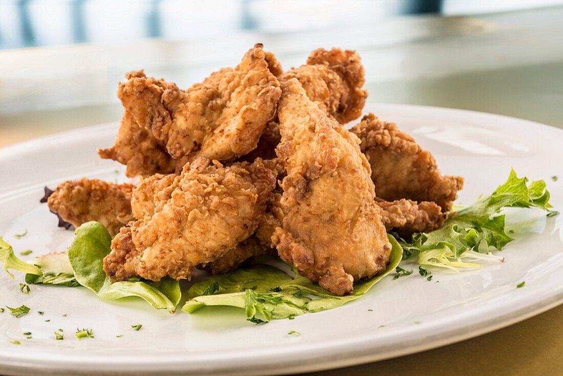 Fried chicken tenders on lettuce