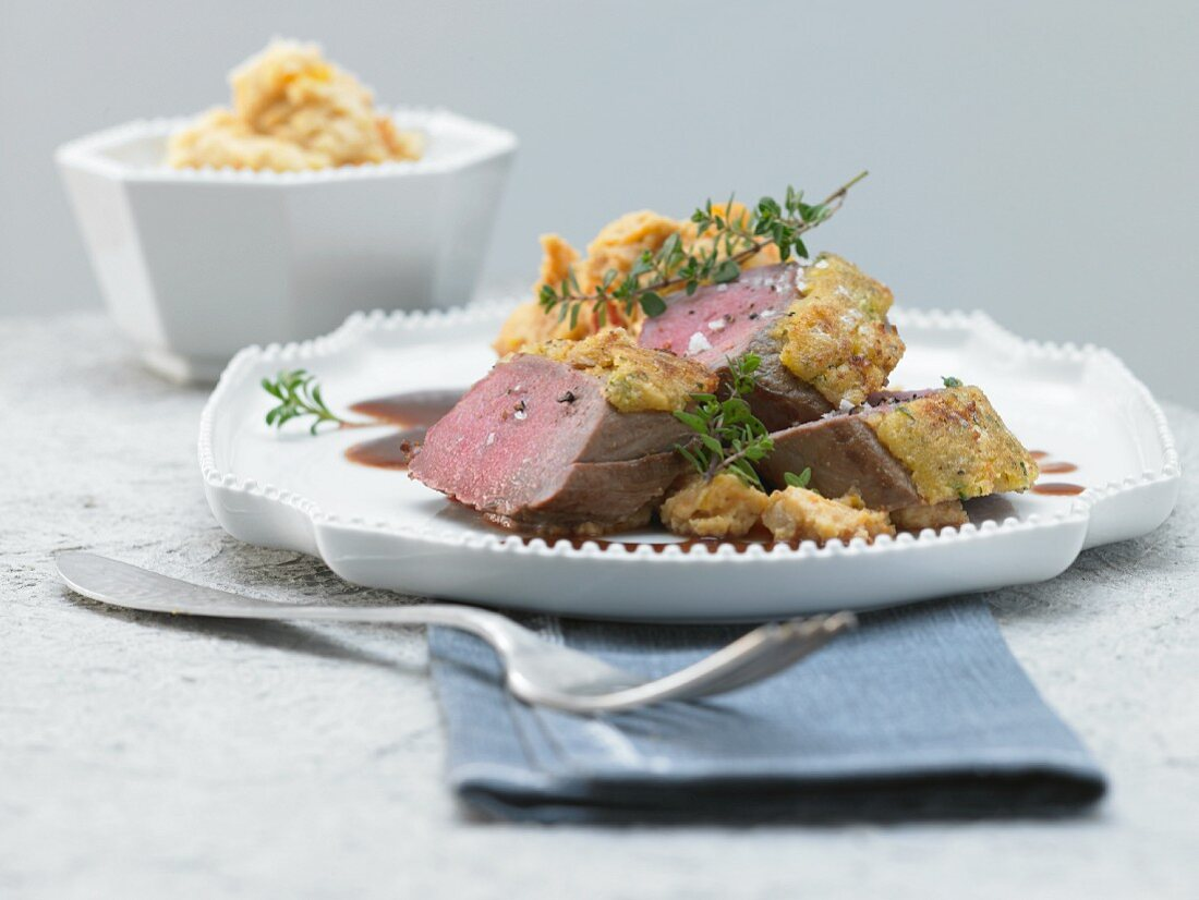 Saddle of venison with a herb nut crust and pumpkin puree