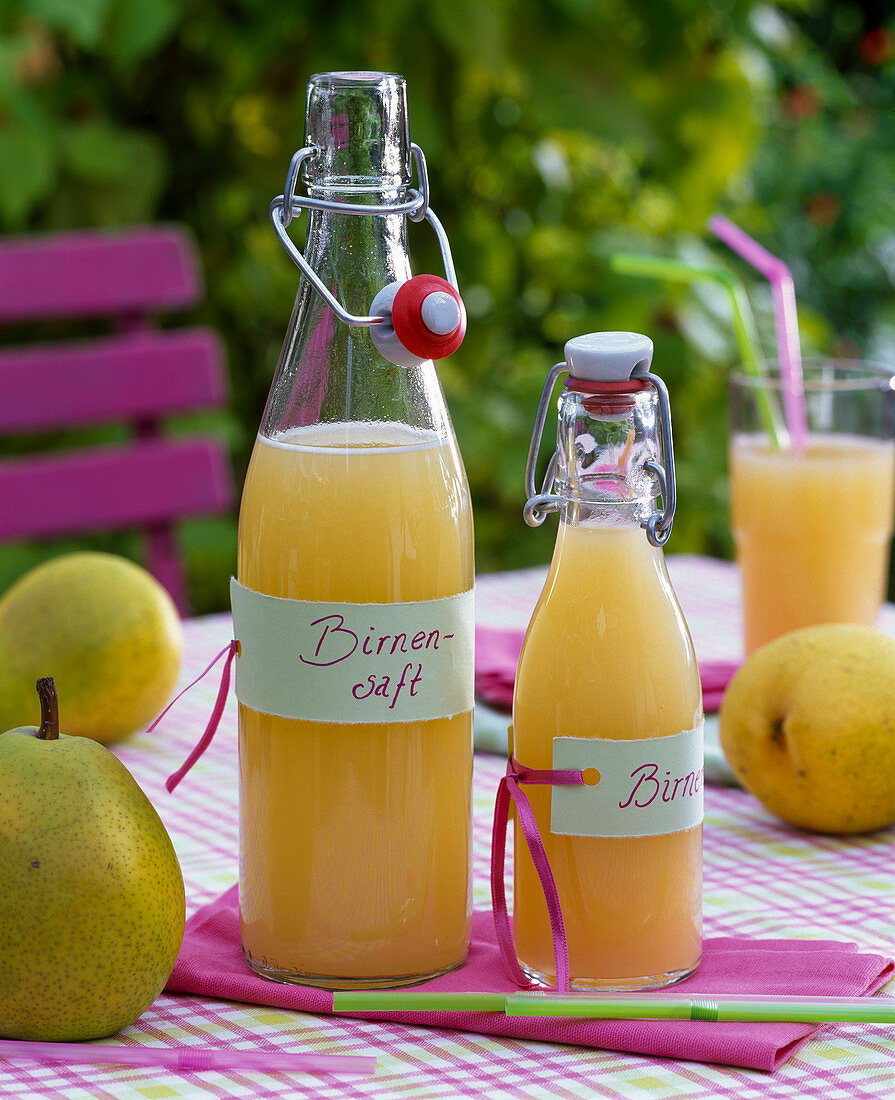 Pyrus juice in ironing bottles with labels 'Birnensaft'