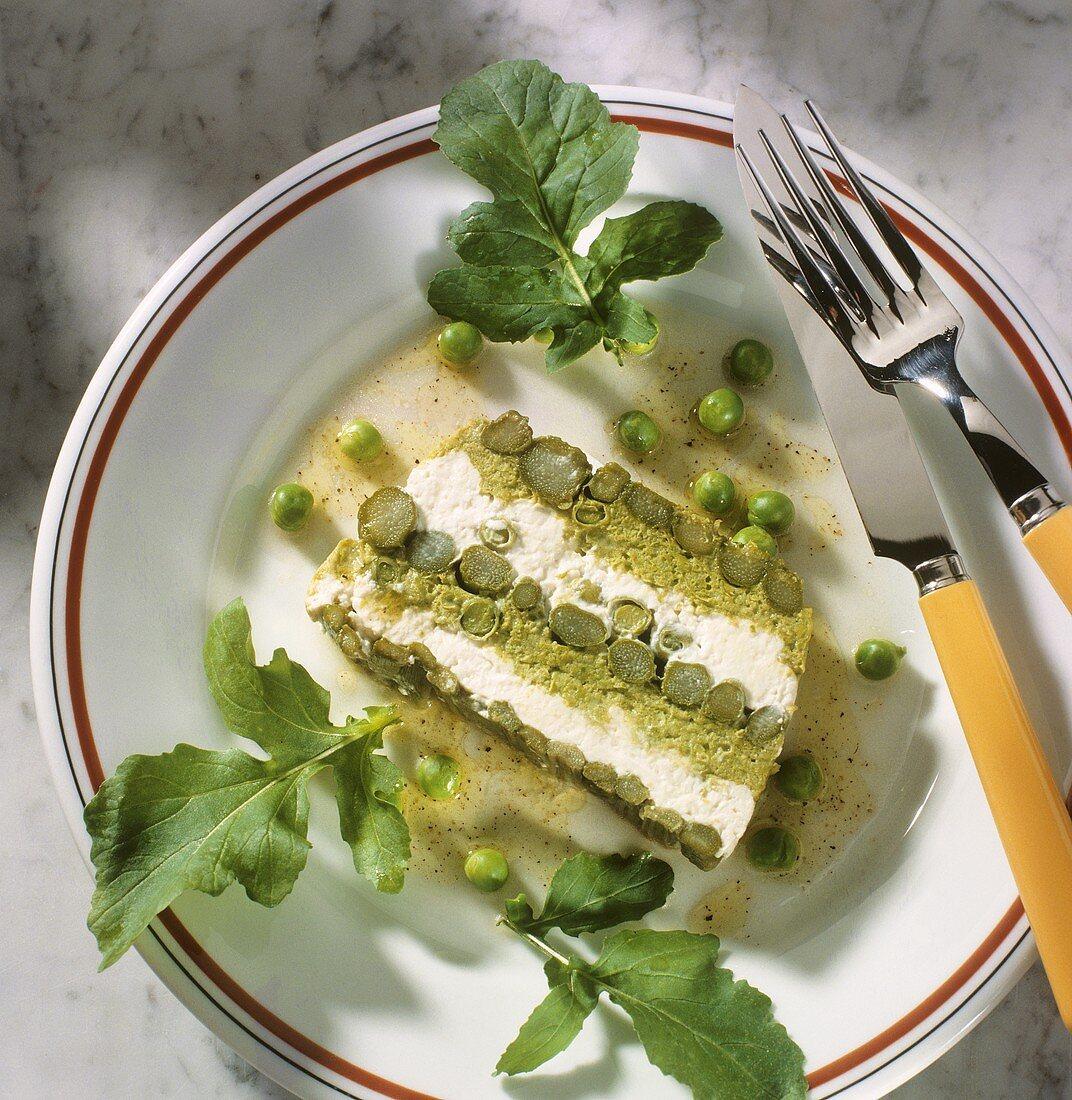 A slice of spring terrine with asparagus, peas & cream cheese