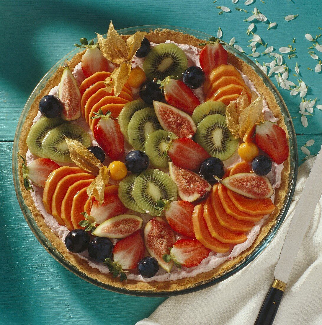 Fruit tart with papaya, figs, kiwi fruit, grapes, strawberries