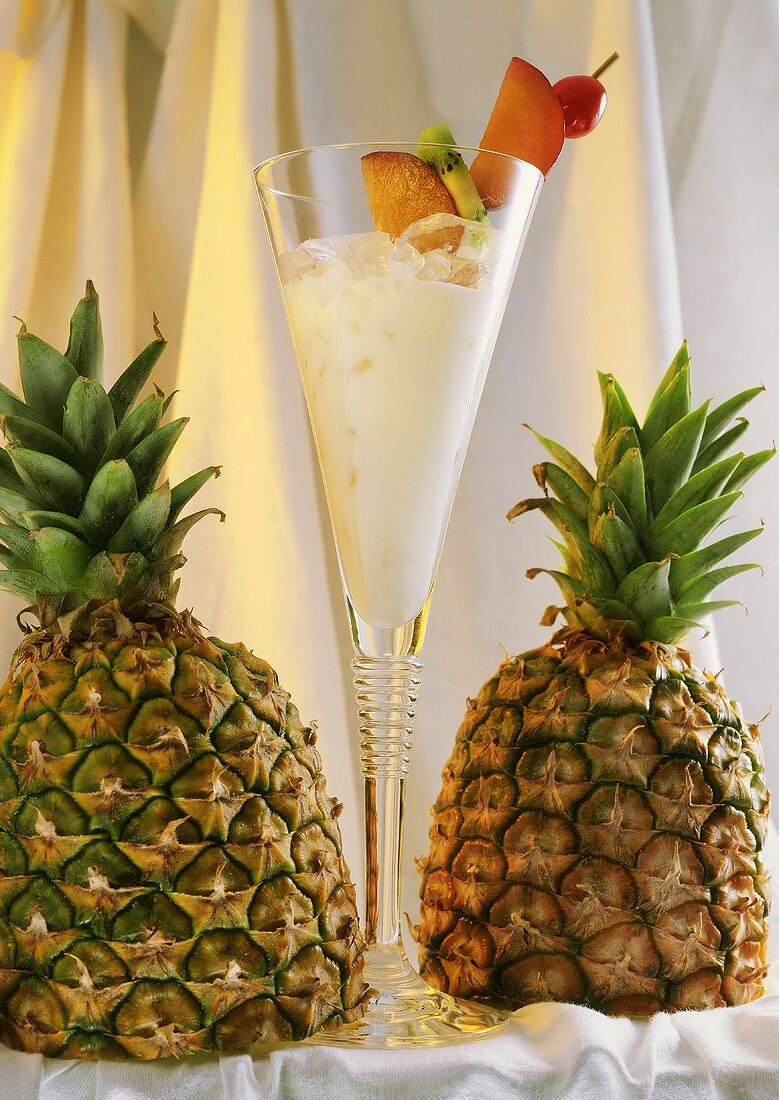 Pina Colada in a Glass with Two Pineapples