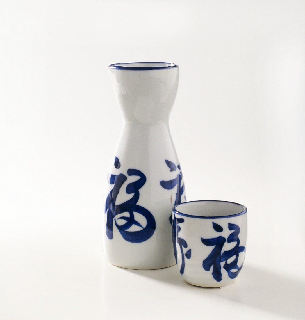 Asian Sake Bottle and Sake Cup
