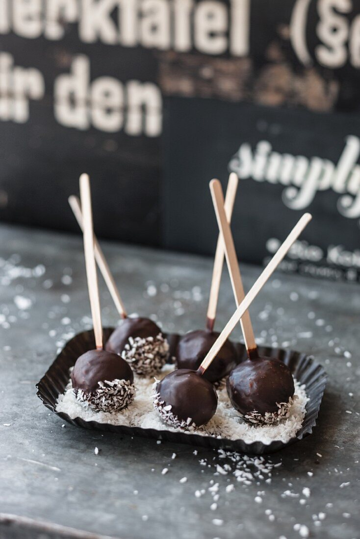 Chocolate cake pops with coconut flakes