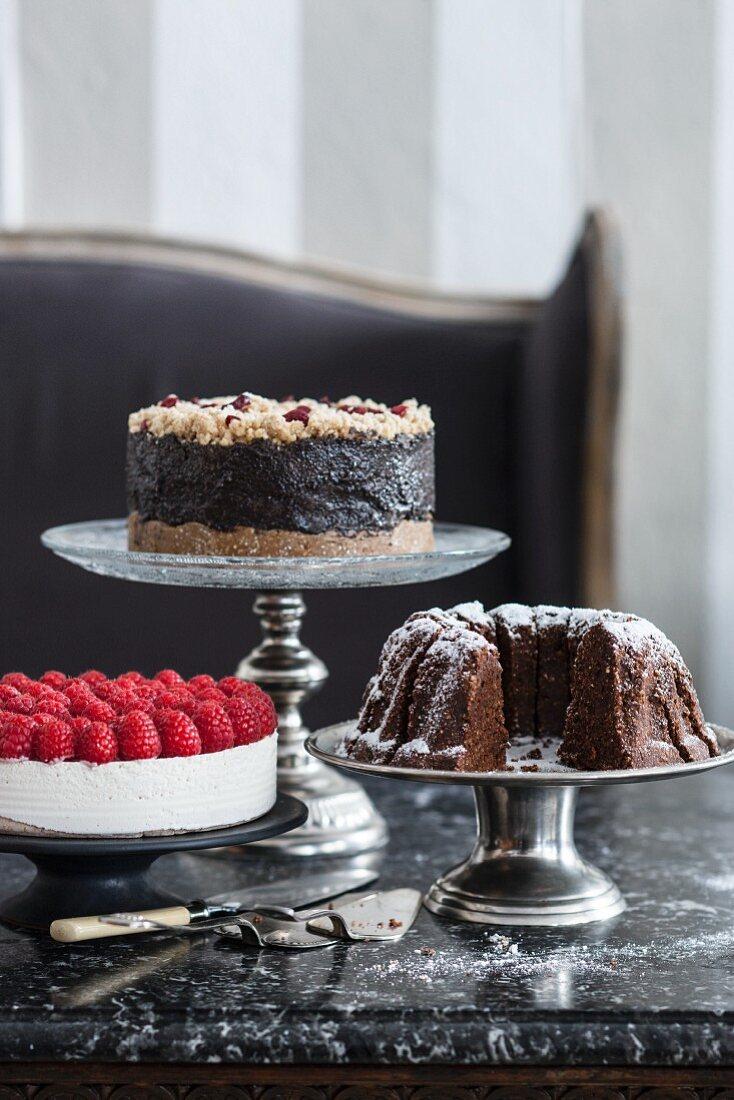 Vegan cakes and tarts on étagères in a café