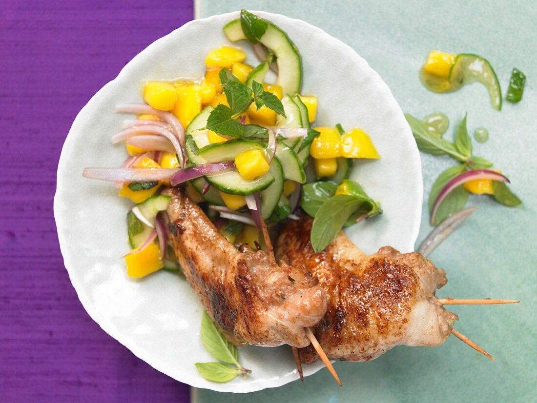 Stuffed chicken wings with prawns and a mango salad
