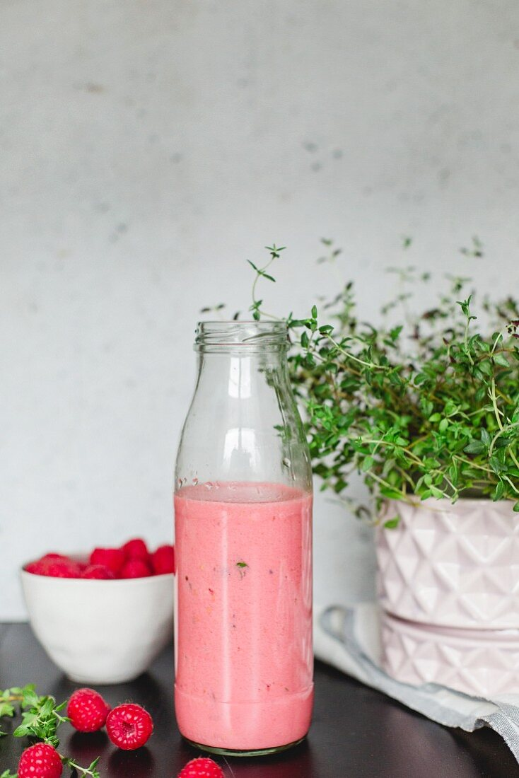 Cabbage and raspberry shake in a bottle