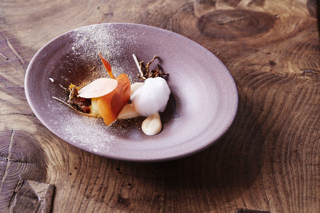 Coltsfoot ice cream with parsnip and vinegar aged in an oak barrel served at the 'Oaxen Krog' restaurant in Stockholm