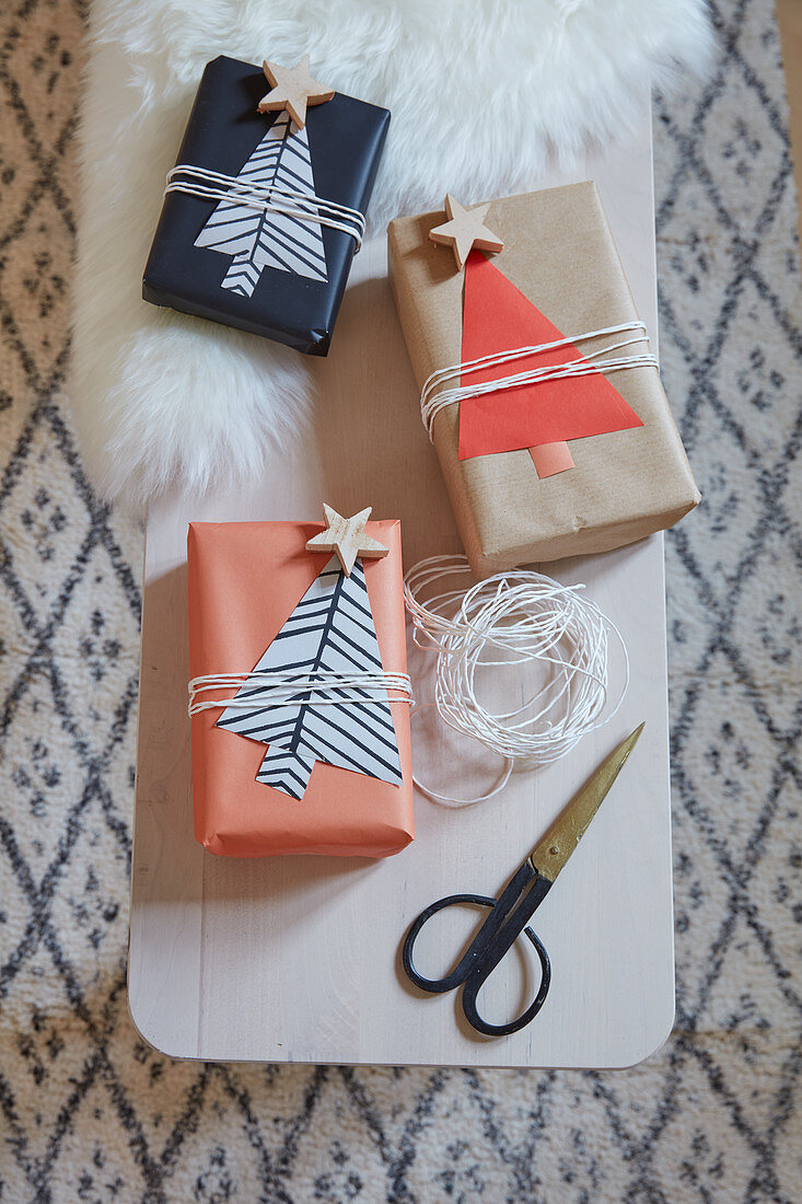 Wrapped gifts with paper Christmas tree gift tags