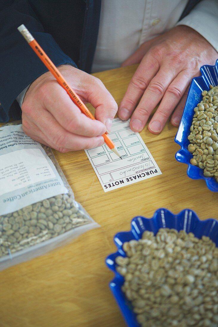 Wilhelm Andraschko rating the coffee samples in his coffee roastery in Berlin