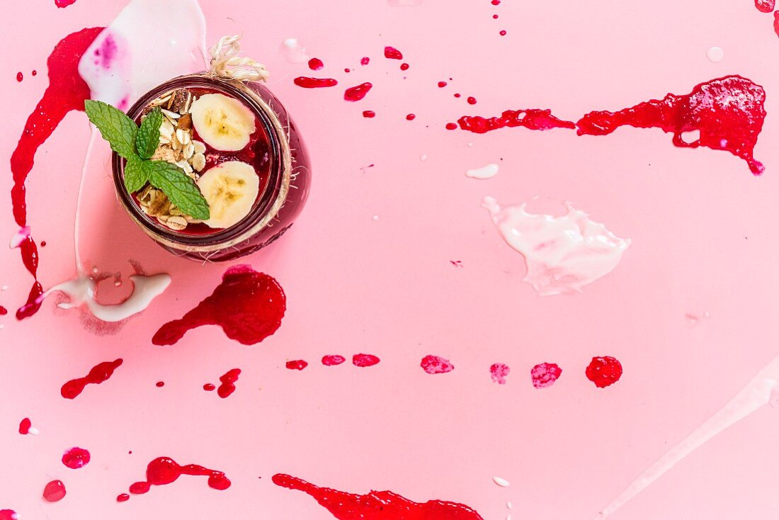 Beet soup in a white bowl on colored construction paper surface - healthy food