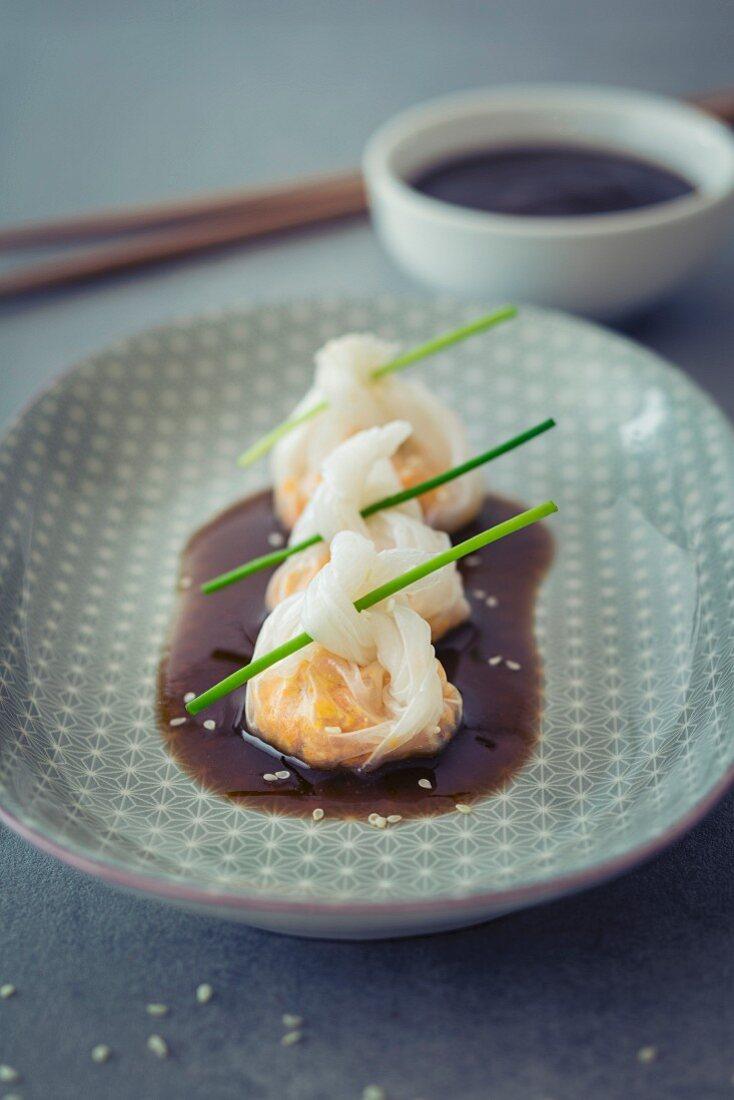 Dim sum with plum sauce (Asia)