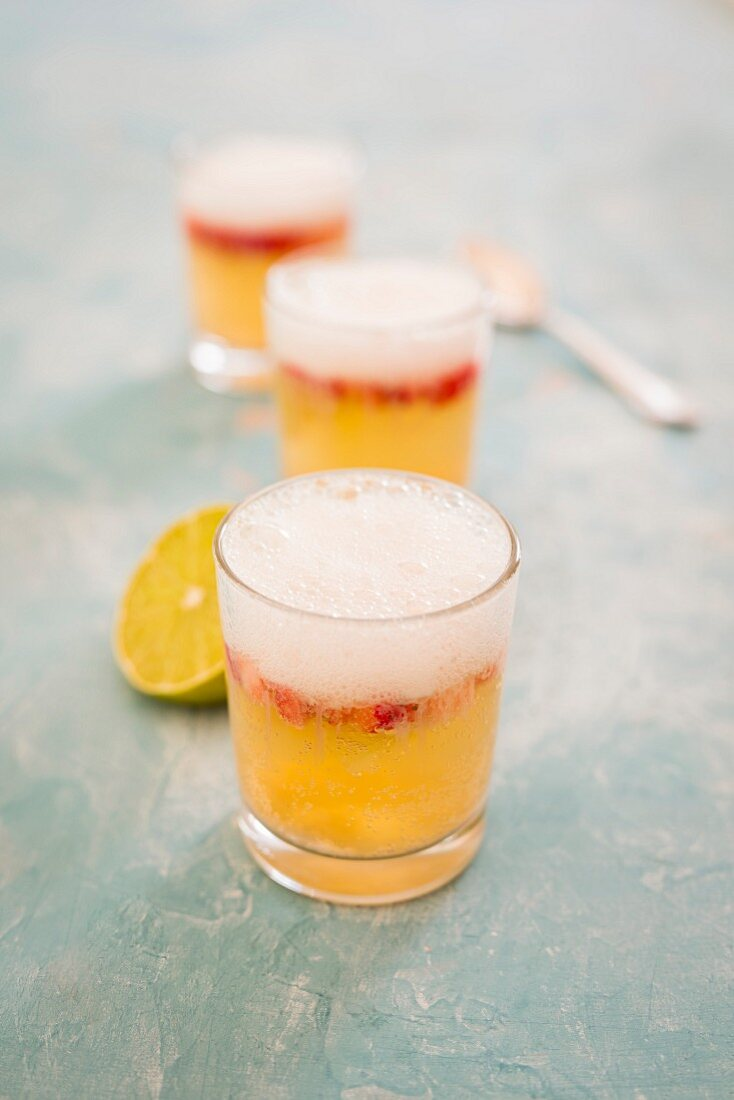 Wheat beer punch with a lime foam