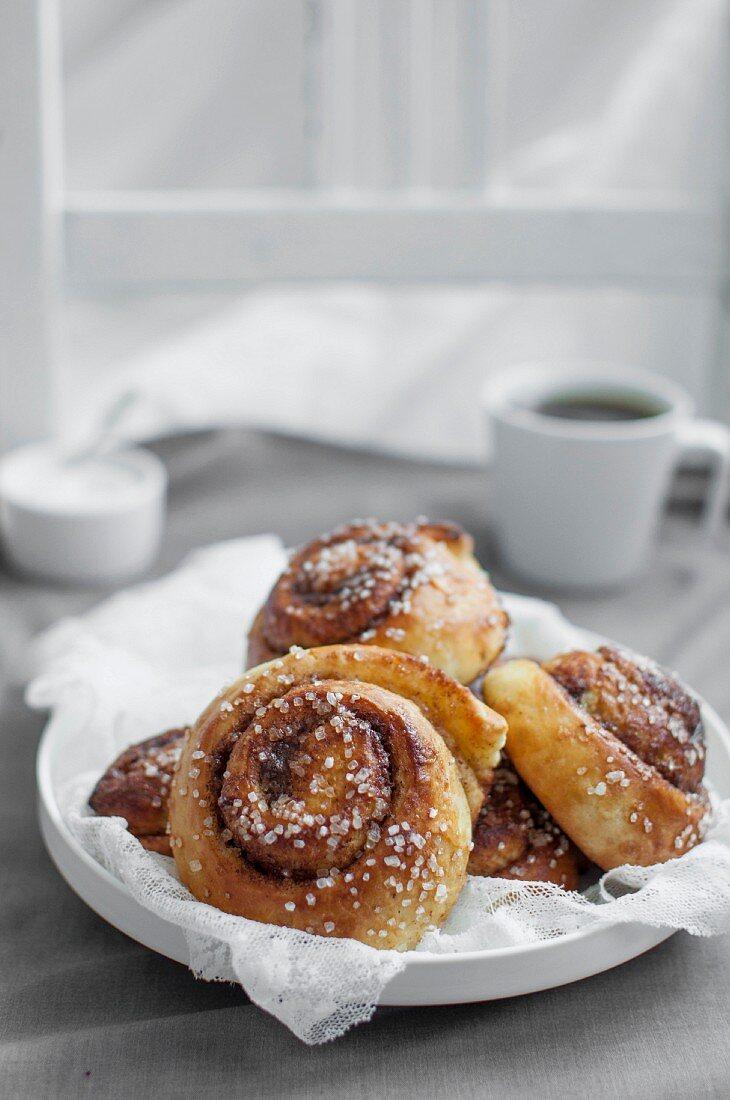 Kanelbullar (Swedish cinnamon buns) served with cup of coffee