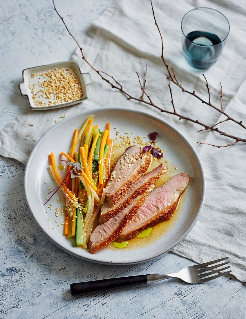 Miso-marinated duck breast with sesame seeds and vegetable strips (low carb)