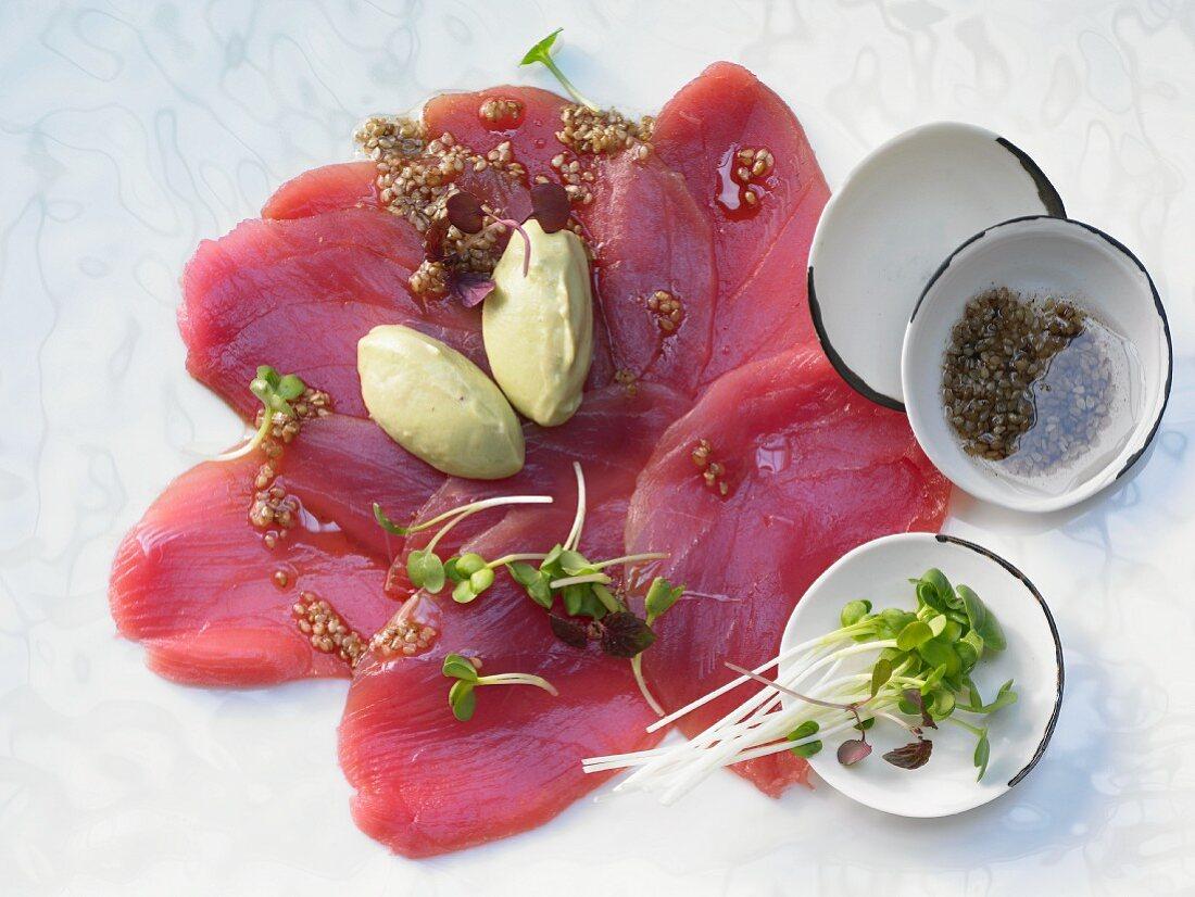 Tuna carpaccio with avocado cream and sesame seeds