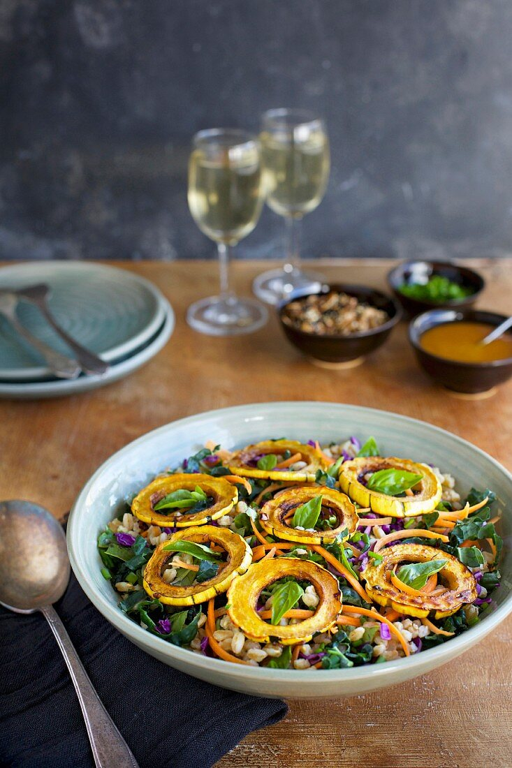 Sesame Farro Salad with Delicata Squash served with dressing, toasted nuts, chives and white wine
