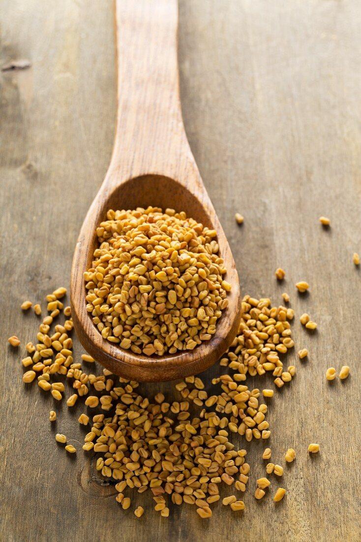 Whole buckwheat bran seeds on wooden spoon