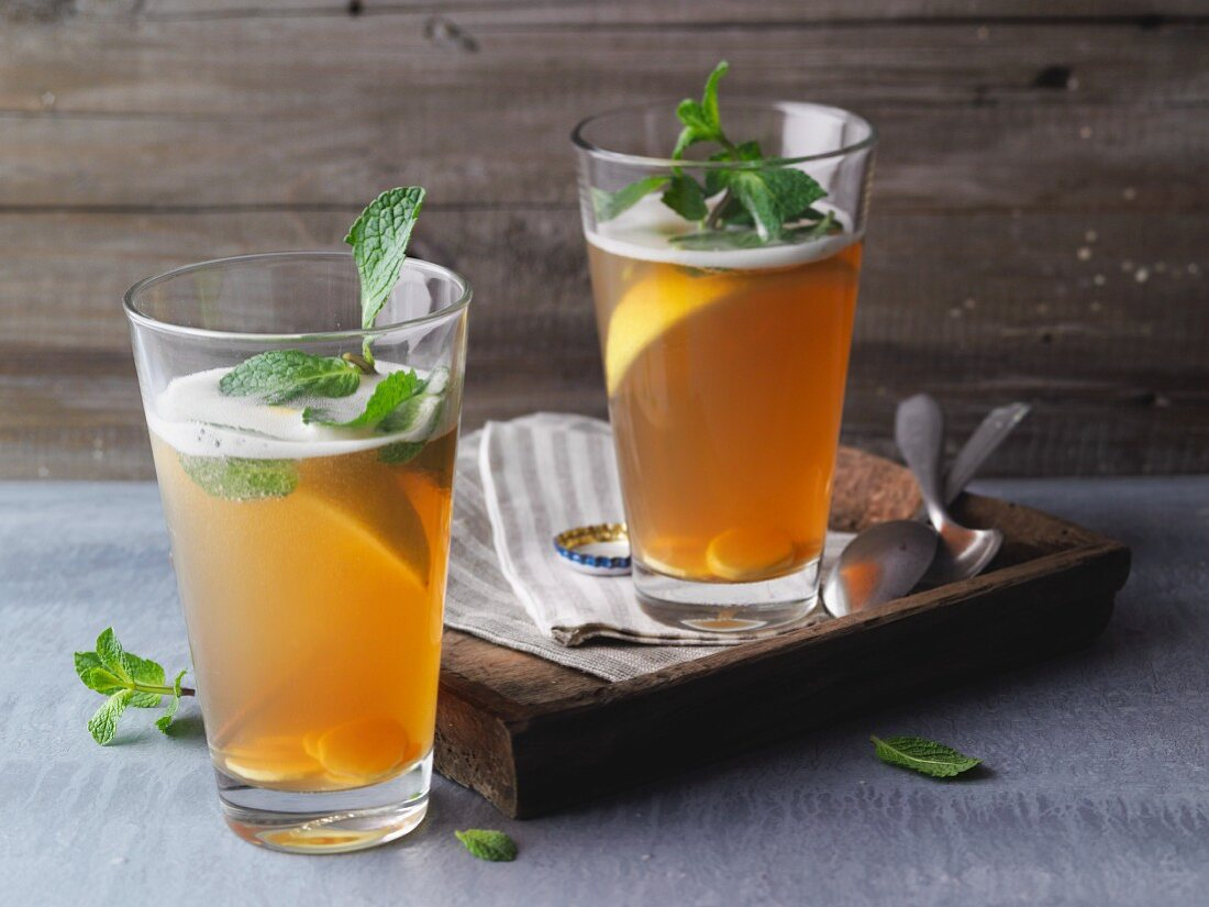 Tea and beer spritzer with non-alcoholic ginger beer