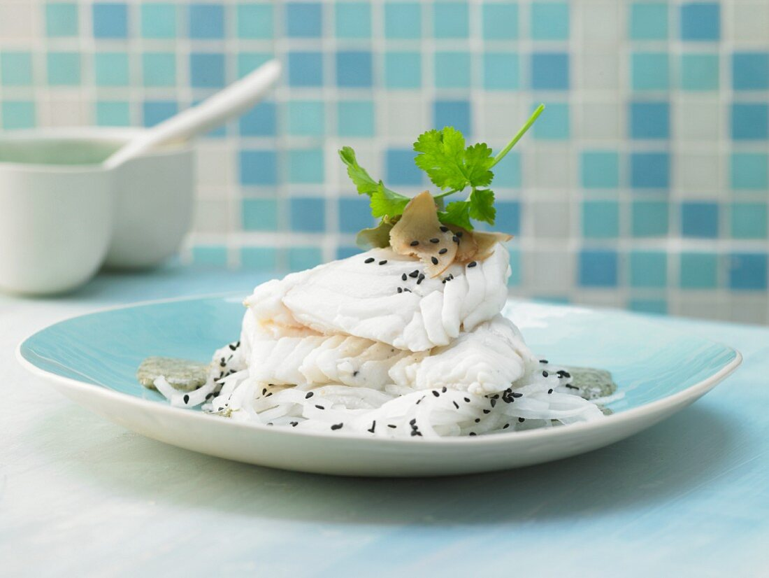 Steamed cod cuts with an algae and coriander pesto and white radish