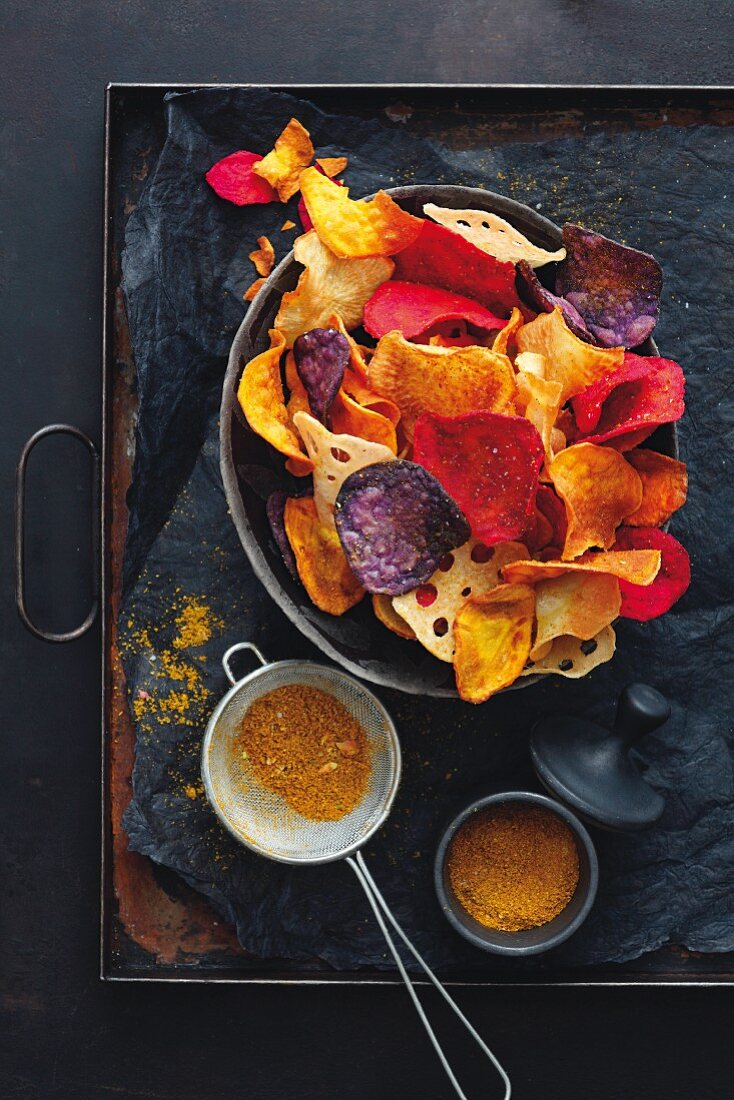 Colourful vegetable chips with ras el hanout spice mix