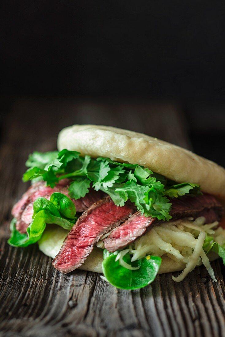 A bao burger with rump steak