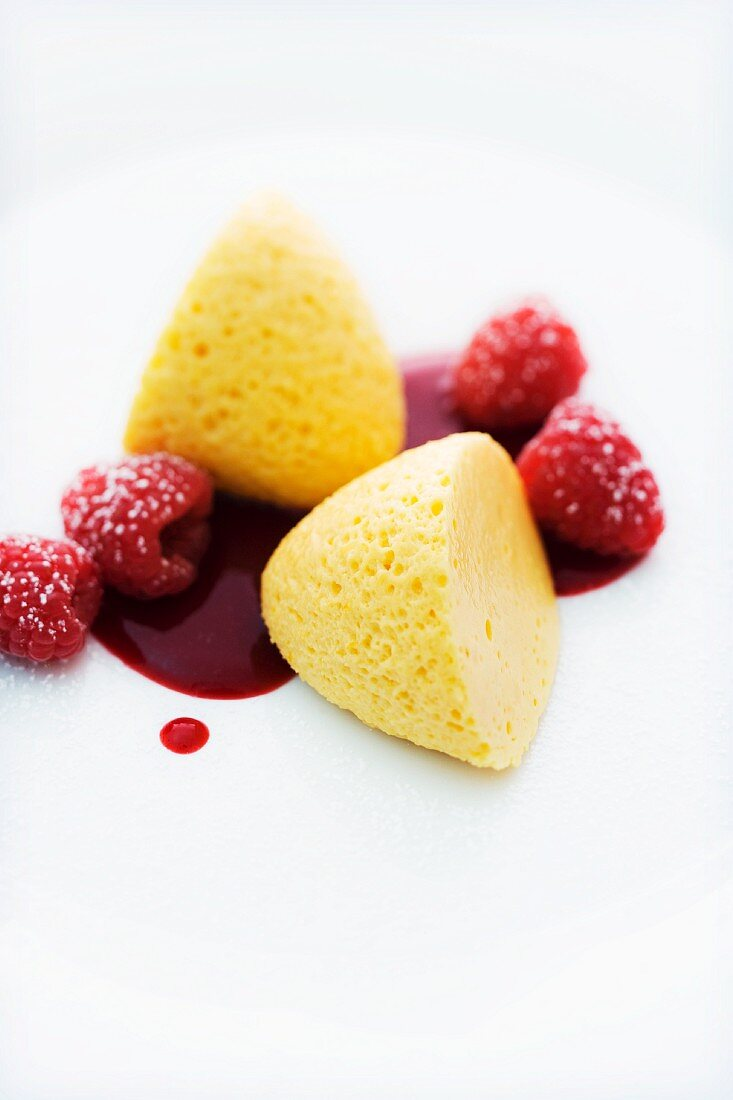 White passion fruit mousse with raspberry sauce