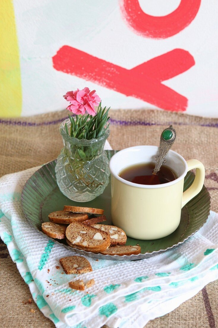 Cantuccini to be served with coffee in an enamel cup on a metal plate
