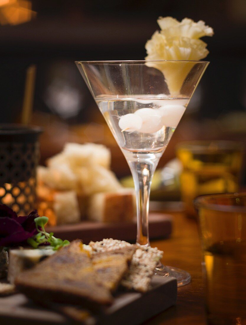 Gibson cocktail with pearl onions and tete de moine in a bar (Melbourne, Australia)