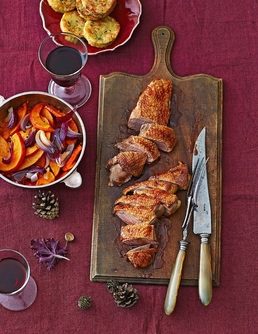 Goose breast with pumpkin and red onion