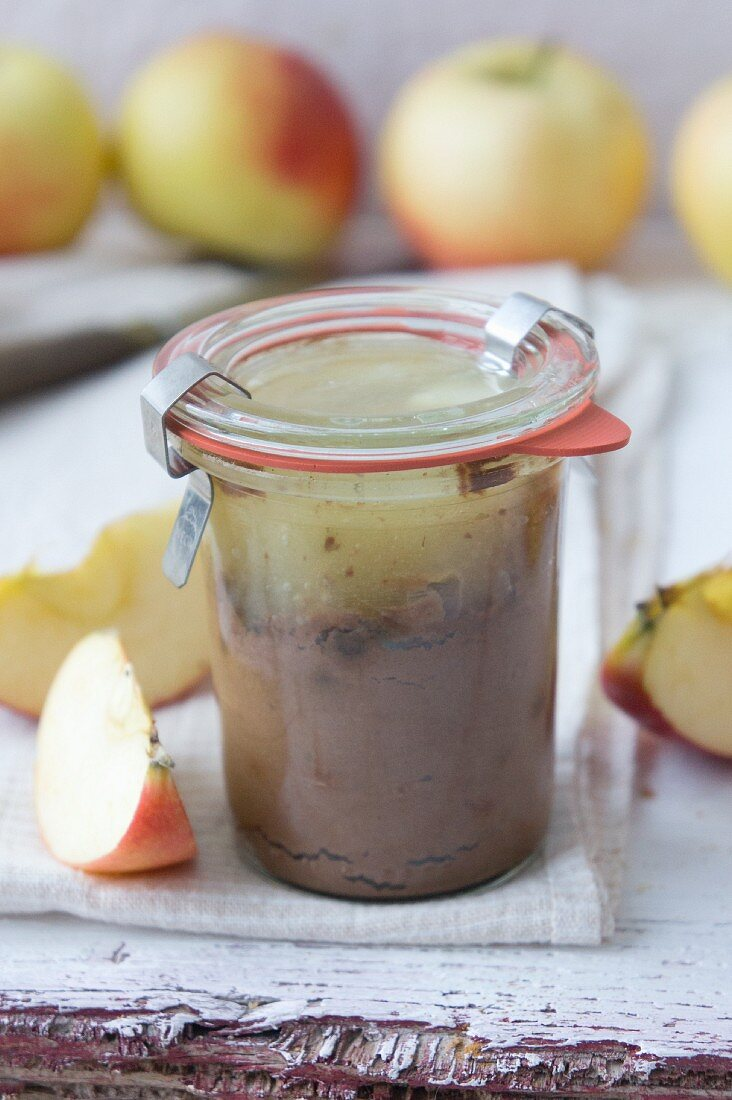 Mousse au chocolat with apple sauce in a glass jar