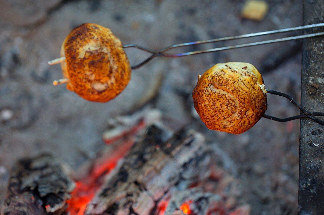 Cinnamon rolls on skewers, close-up