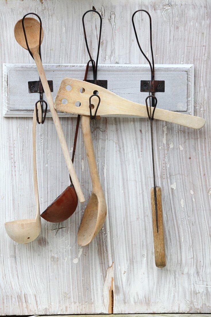 Various kitchen utensils hanging on hooks