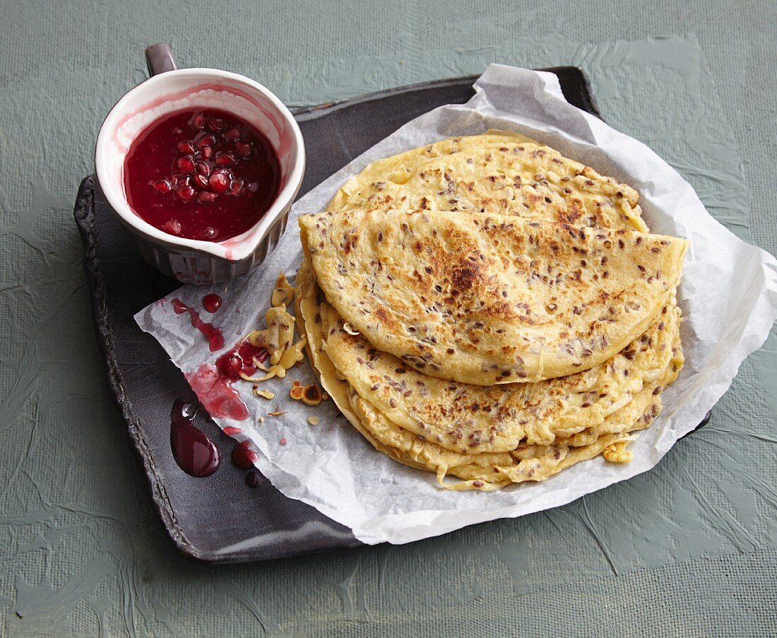 Spelt pancakes with linseeds and pomegranate sauce