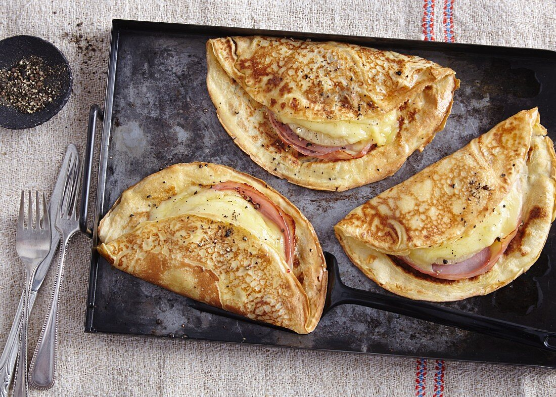 Hawaii pancakes filled with ham, cheese and pineapple