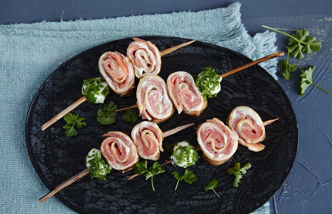 Crêpe rolls with smoked salmon on skewers