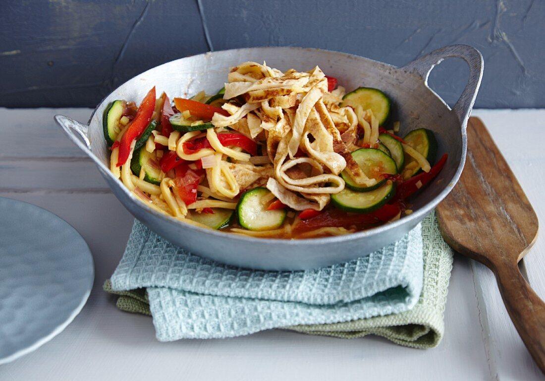 Mediterranean wok-fried vegetables with pancake strips
