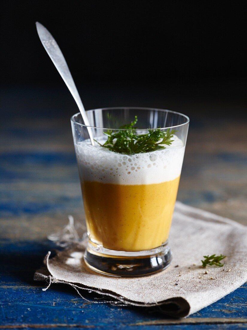 A glass of carrot macchiato