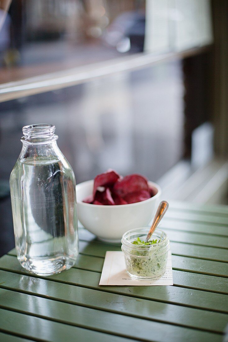 Beetroot chips with fresh cheese and herbs