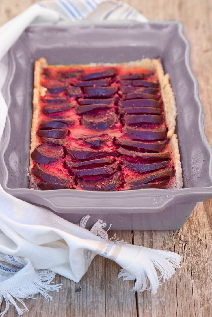 Beetroot quiche in a baking tin