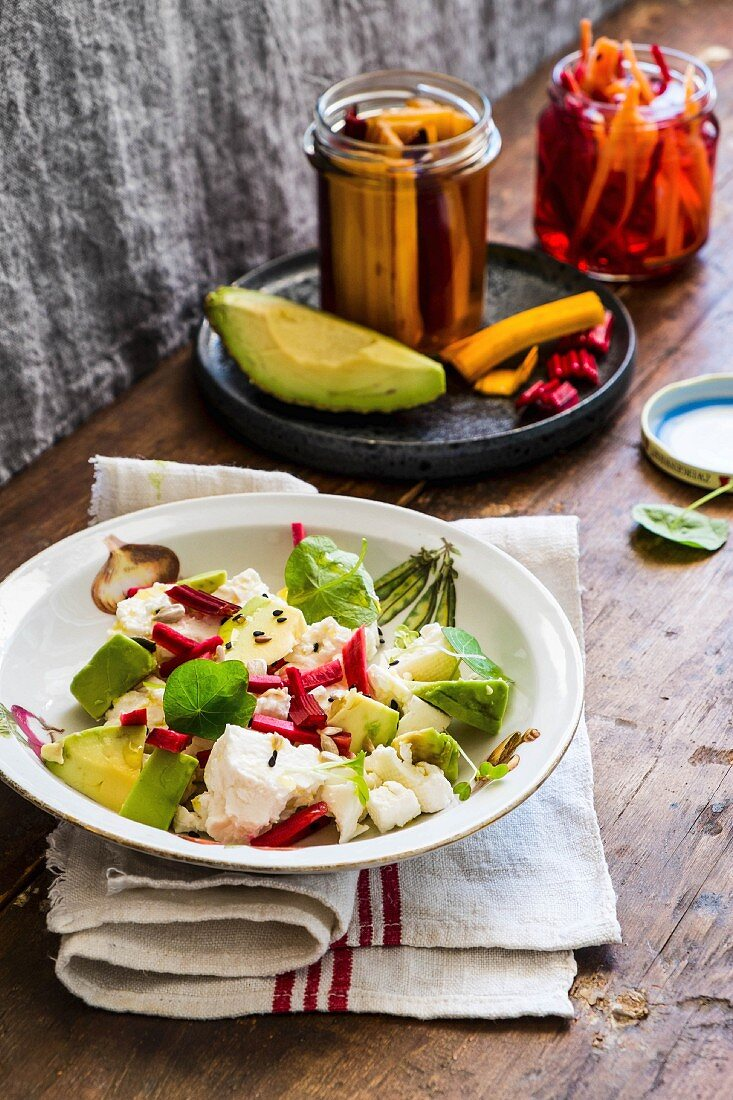 Avocado salad with feta and pickled swiss chard stems
