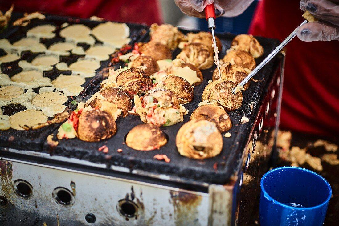 Stuffed Asian dough balls in a street kitchen