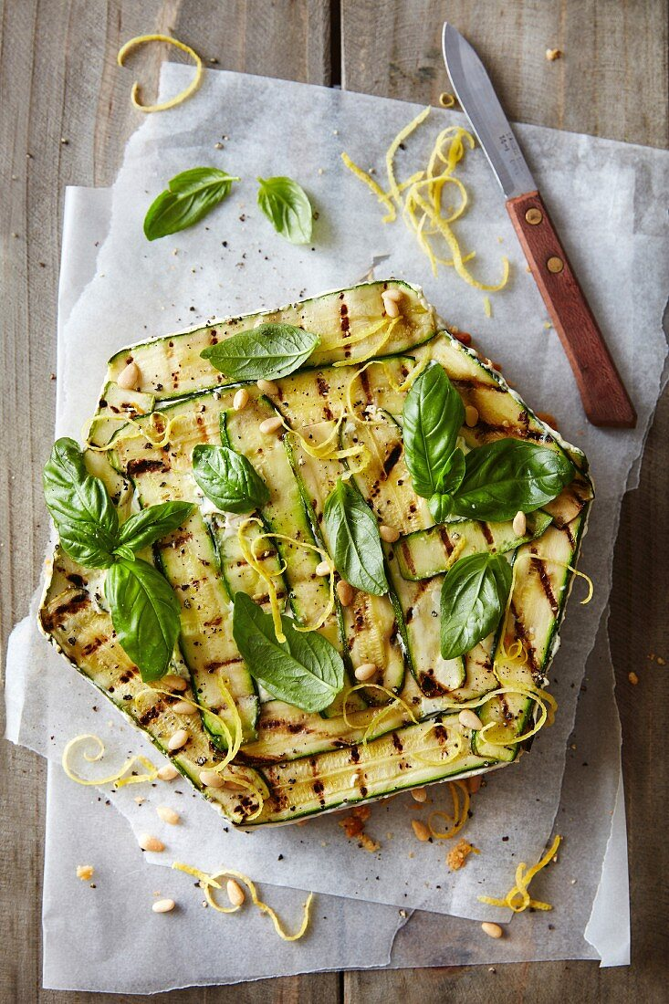 Courgette cheesecake with pine nuts and basil