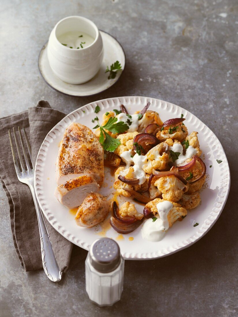 Chicken breast with a cauliflower medley and a yoghurt sauce