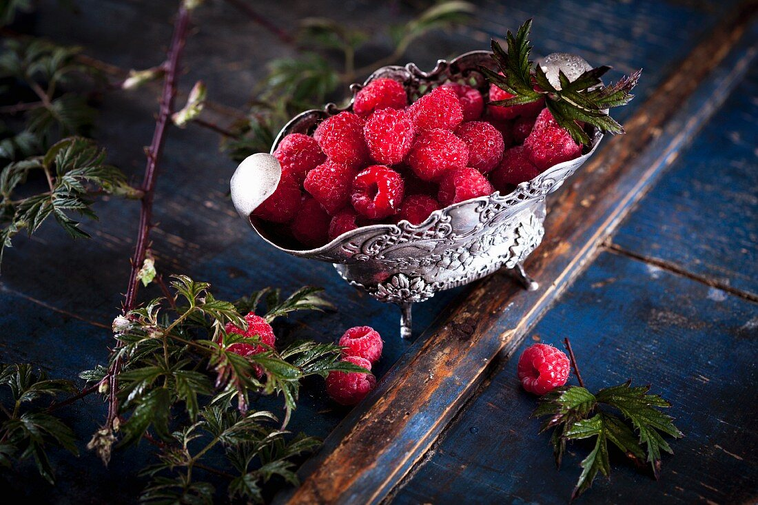Raspberries in a silver Baroque bowl