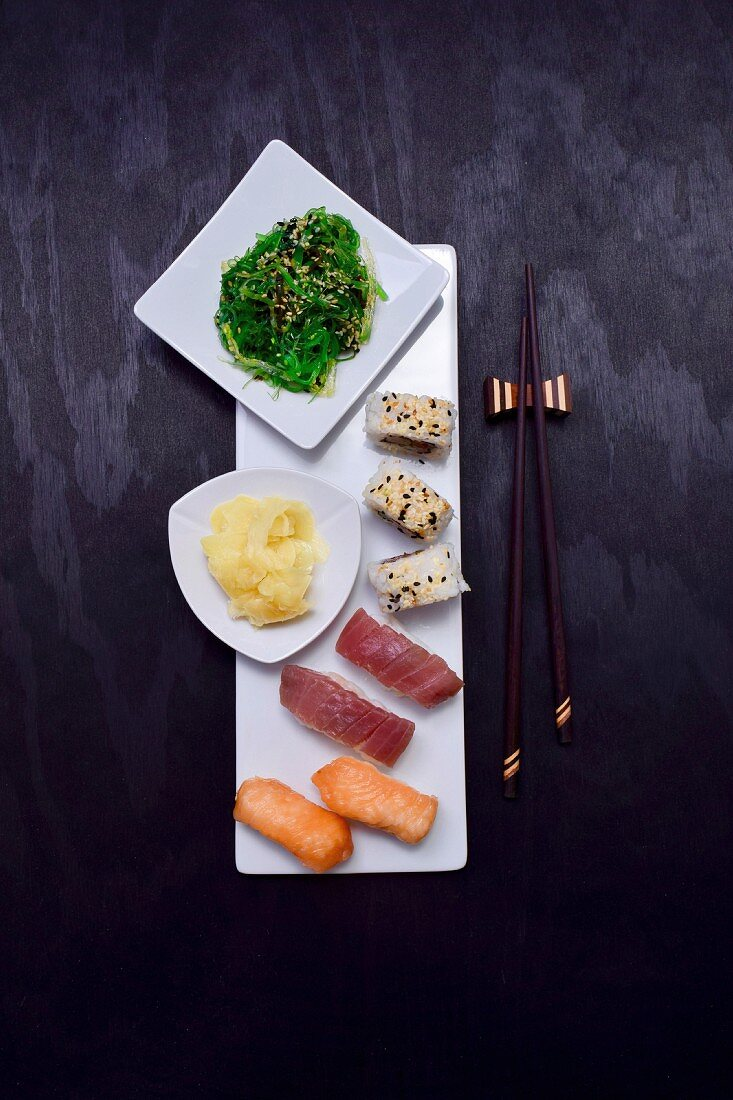 A sushi platter with pickled ginger and an algae salad (Japan)