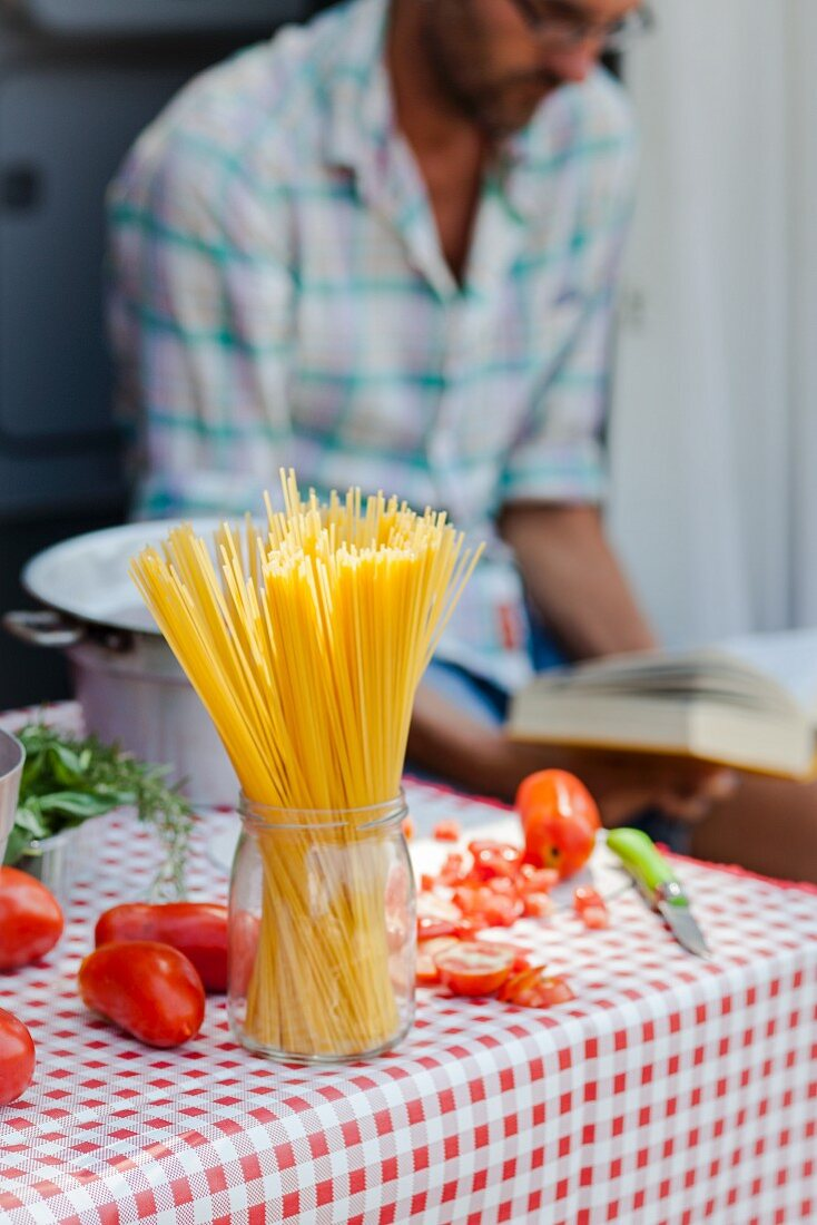 Spaghetti and tomatoes on a table