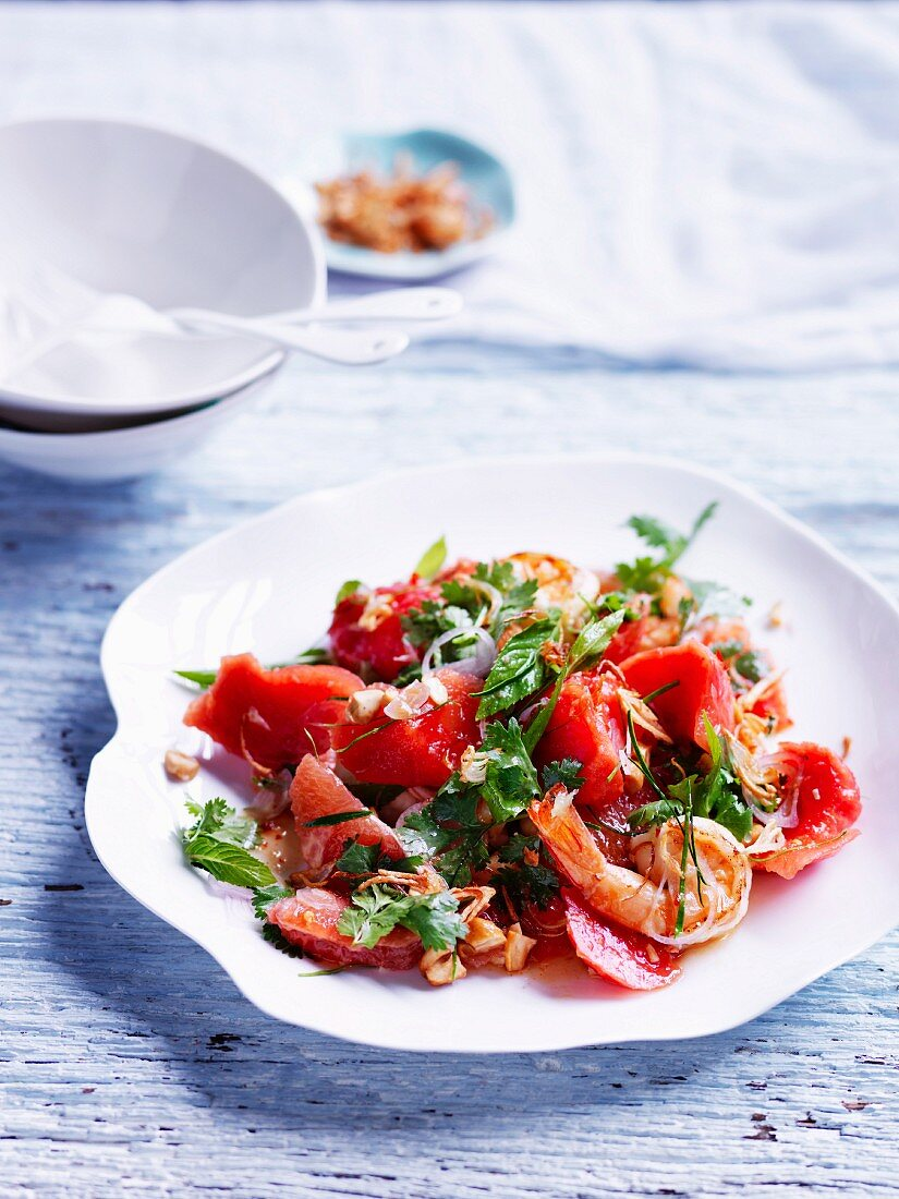 Sweet and sour watermelon salad with pink grapefruit and prawns