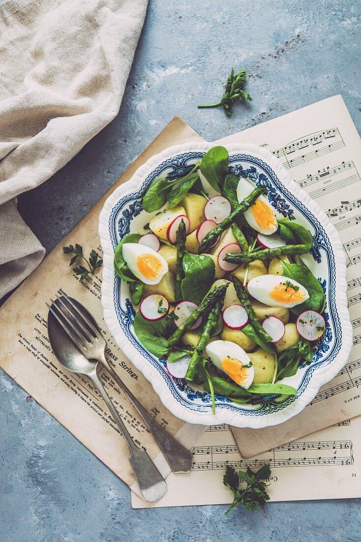 Potato salad with asparagus and radishes