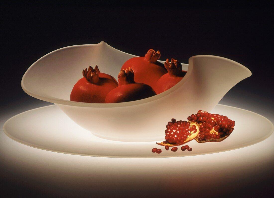 Pomegranates in a white glass bowl